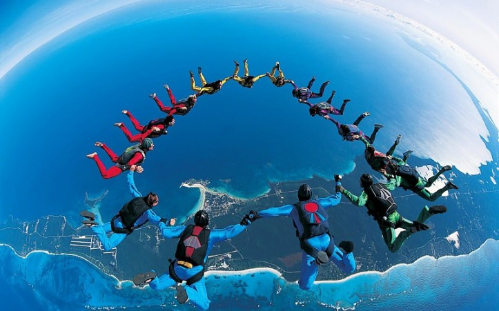 blue-sky-cool-fall-flying-ground-hand-in-hand-highly-toxic-jump-looking-down-parachute-parachute-jumping-photo-picture-sky-skydiving-sport-the-skydivers-together-wallpaper-445013